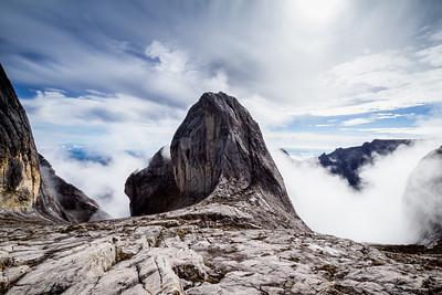 Clouds building around Victoria Peak (4091 m). Mount Kinabalu, Borneo.