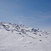 Hikers approach Mount Washington.