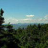 View south from Mount Pierce to L to R Mount Passaconaway, Mount Whiteface, the Sleepers and Tripyramids.