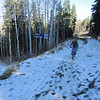 As elevation is gained snow remains from a previous storm.  This is natural snow shaded from melting.  Although single track exists, at this point we need to use the service road.  You can ride through this snow, as shown.