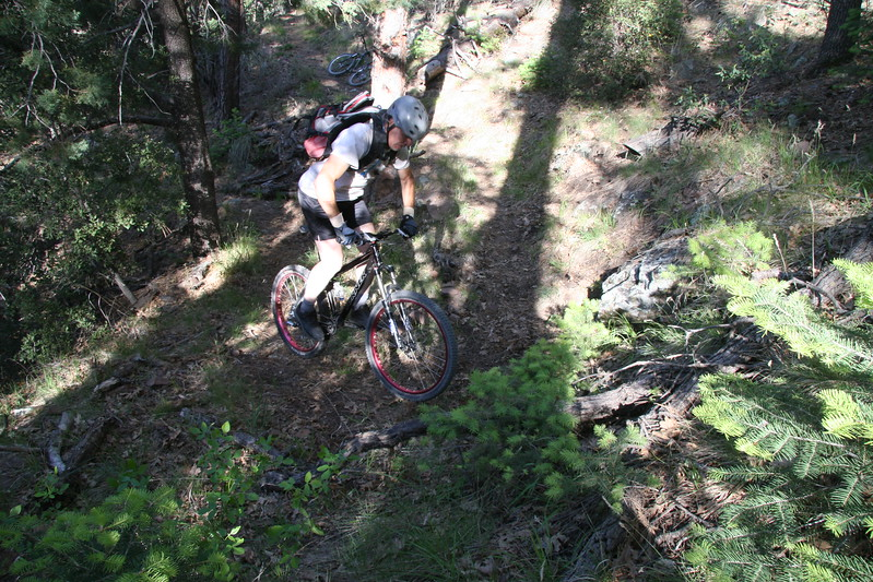 Coming up hill towards a switch back.  Part 2<br /> Rolling the tire into the bend and chip the bike around.