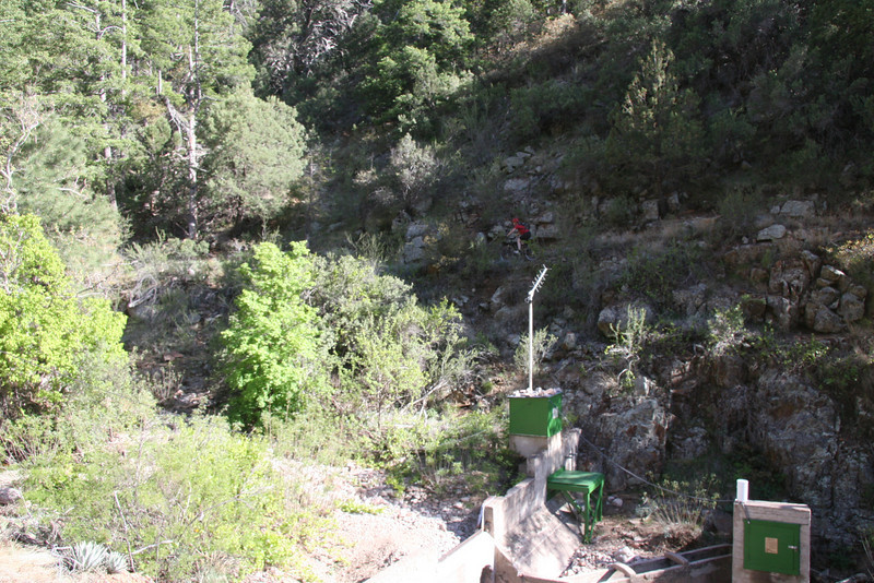"""The government likes to piss away your money.  Here's a hydrological measurement station that's defunct.  Jeannie rides in the background on an 8"""" trail section."""