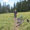 I meet Tristan at Willamette Mountain Mercantile (local bike shop in Oakridge, OR) and put together a D/H ride through the Alpine Trail.  We climb .86 miles to this meadow at 4,800 feet elevation.  At the tree line begins the D/H single track.