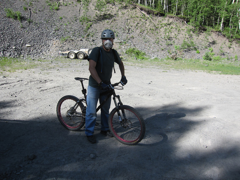Here Scott is getting ready to ride up Camp Bird Road.  He will climb a total of 1000' starting at an elevation of 9,600'.  Camp Bird Road gets very dusty after a few days of no rain.  A dust mask is worn to avoid inhaling unwanted particles.