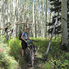 Shannon and I rest in this aspen glade before continuing onward to what I regard as the best part of this ride.  Weather remains perfect with cool temps, clear skies. light winds and dry trails during our all day outing.