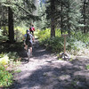 Here we are on the Blaine Basin Tr which turns left per the sign.  Shannon follows Pat up the trail.