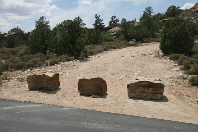A trilogy of welcome stones greets the mountain biker attempting to access the trail at a more appropriate location.
