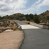 Black top and naked white cement adorns this residential area.  In Mesa, AZ such cement structures are colored to match the desert scheme.  Cost containment measures do come in many colors I guess.  A piece of the parking area we used is shown on left and the only one we found within the Anasazi subdivision.