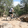 Lifting the front wheel up helps the transition onto these rock plates.  Anyone with reasonable MTB skills would be fine here.