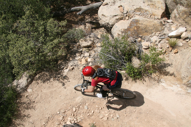 Rolling around a tight corner on the way down hill towards the wash.