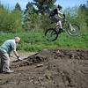 Scott Laird of City of Vernonia packing beginner jump as Ryan McLane of W.T.F. tests intermediate jump next to it