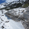An avalanche fault line is clearly evident.  I hear this snow mass creaking in the hot sun.  We move away just to be on the safe side.