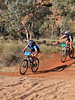 Janine Ridsdale (Vet. Women) leads Imogen Smith (Open Women) over the Todd River to complete the 1st lap of the Prologue
