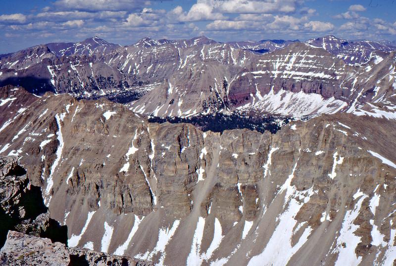 Photo taken from North ridge of LaMotte Peak. Yard Peak is on the ridge behind (reddish base).