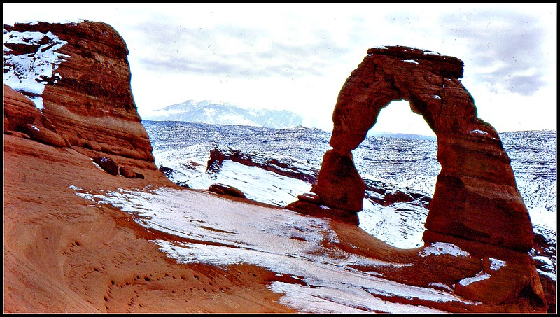 A photo taken of Delicate Arch in winter.