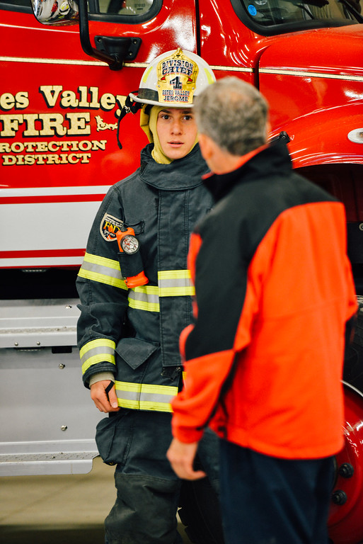 . A young man tried out a Firefighter\'s uniform. (Trail-Gazette)