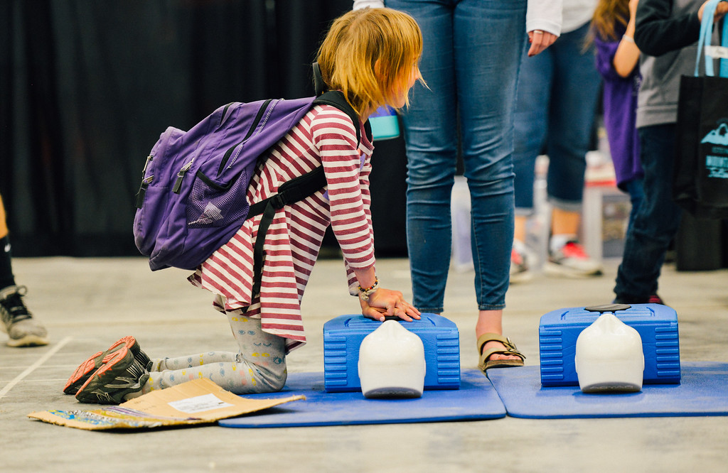 . A young girl learns CPR. (Trail-Gazette)
