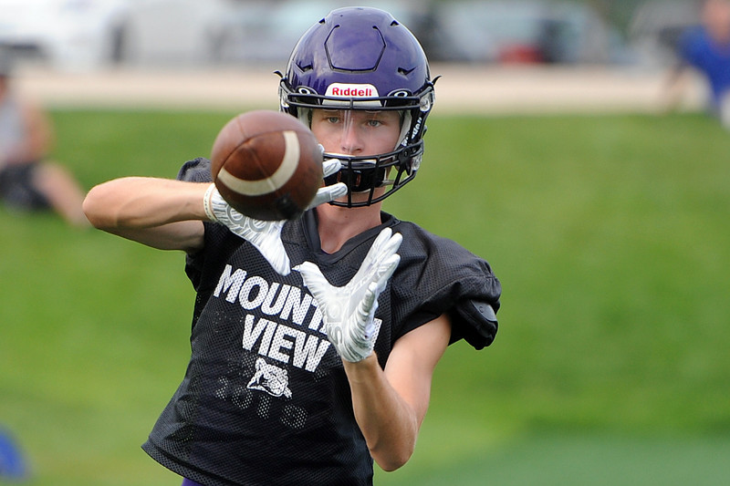 Mountain View's Dylan Naughton looks in a pass before a scrimmage Thursday, Aug. 16, 2018 at Loveland Sports Park. (Sean Star/Loveland Reporter-Herald)