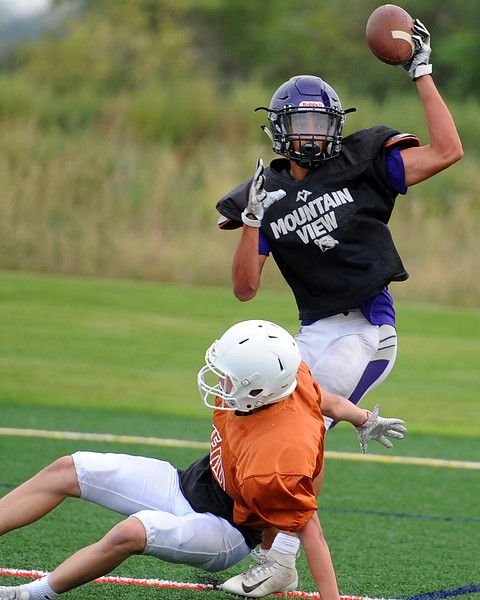 Mountain View's Josiah Baptista comes down with a touchdown catch during a scrimmage against Mead on Thursday, Aug. 16, 2018 at Loveland Sports Park. (Sean Star/Loveland Reporter-Herald)