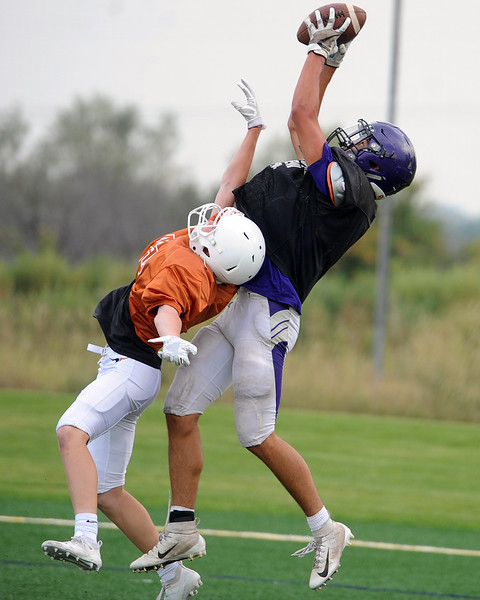 Mountain View's Josiah Baptista comes down with a touchdown grab during a scrimmage Thursday, Aug. 16, 2018 at Loveland Sports Park. (Sean Star/Loveland Reporter-Herald)
