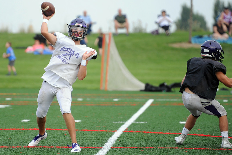 Mountain View quarterback Lukas Arthur attempts a pass during a scrimmage Thursday, Aug. 16, 2018 at Loveland Sports Park. (Sean Star/Loveland Reporter-Herald)