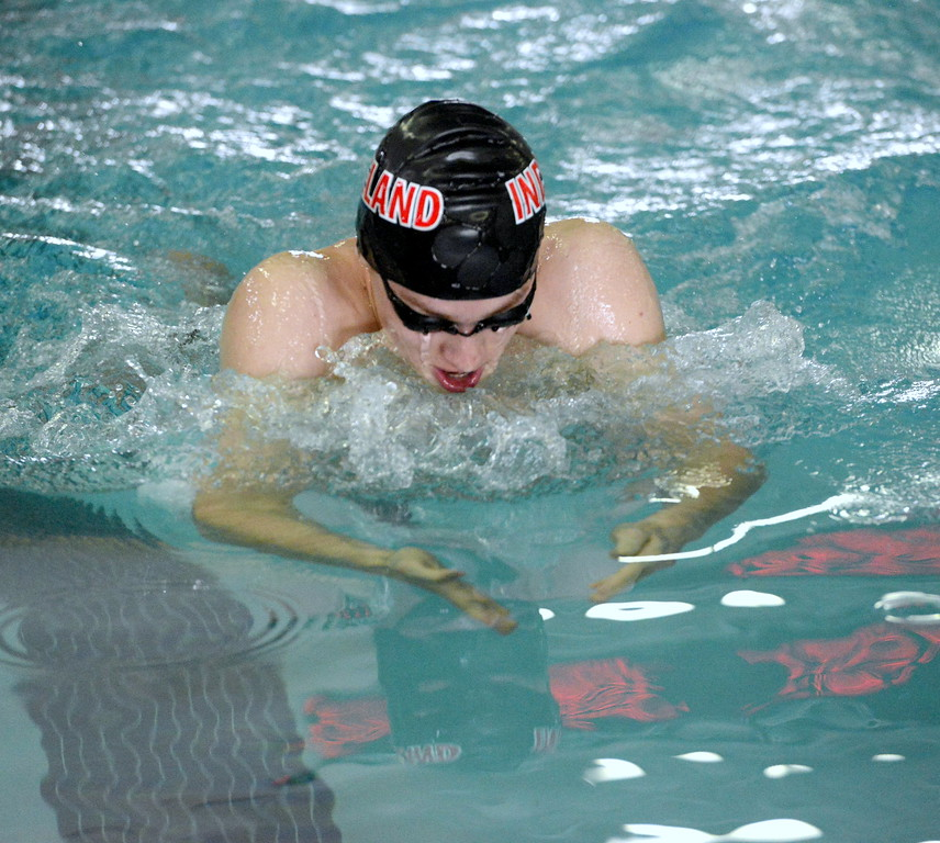 . Caden Denton of Loveland starts his glide forward during the 100 breaststroke Saturday at the Mountain View Invitational.