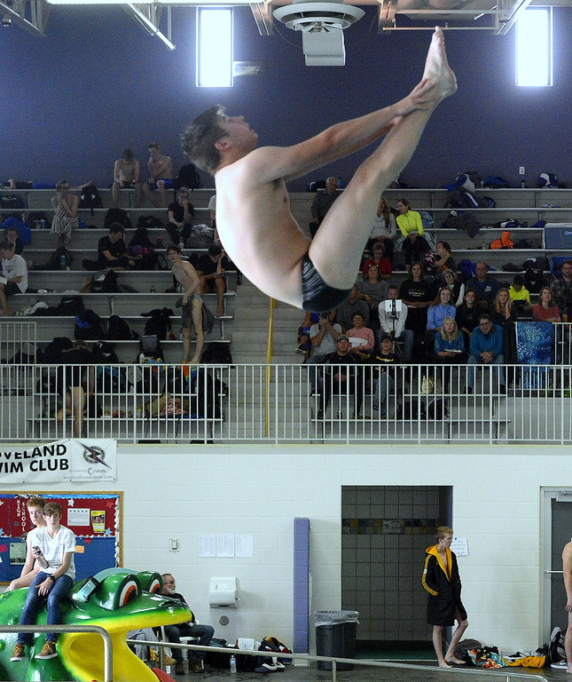 . Thompson Valley\'s Brandon Bicknell gets ready to come out of his pike during the diving competition at the Mountain View Invitational. Bicknell placed third.