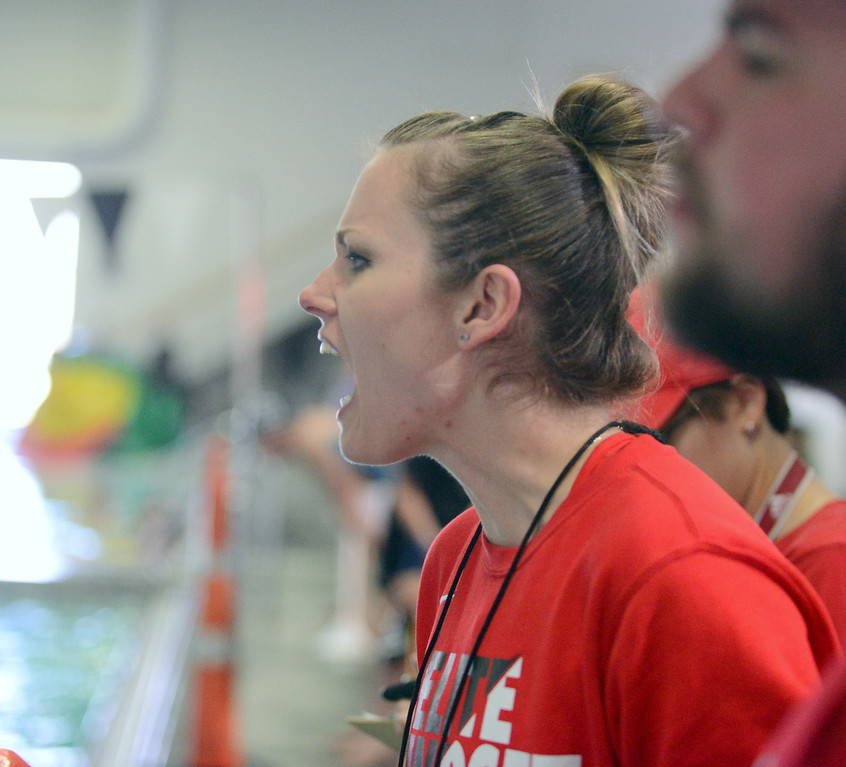 . Loveland coach Sarah Vlatkovich cheers from the deck at Saturday\'s Mountain View Invitational at the Mountain View Aquatic Center. (Mike Brohard/Loveland Reporter-Herald)