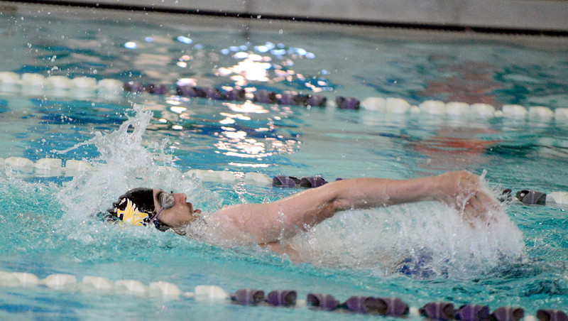 Thompson Valley's Ben Smith swims the backstroke leg on his way to winning the 200-yard individual medley iin 1:57.90 at Saturday's Mountain View Invitational at the Mountain View Aquatic Center. (Mike Brohard/Loveland Reporter-Herald)