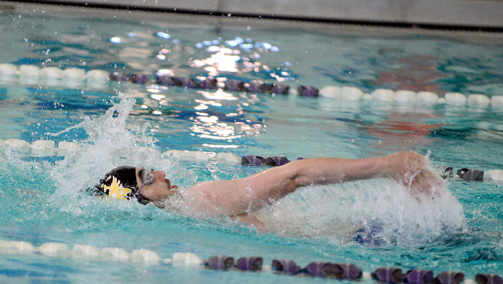 . Thompson Valley\'s Ben Smith swims the backstroke leg on his way to winning the 200-yard individual medley iin 1:57.90 at Saturday\'s Mountain View Invitational at the Mountain View Aquatic Center. (Mike Brohard/Loveland Reporter-Herald)