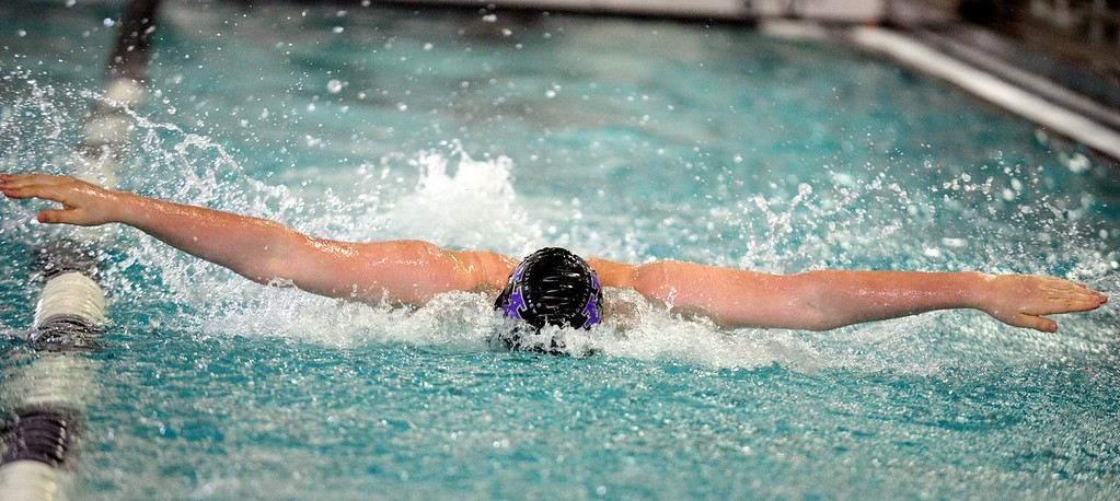 . Mountain View\'s Julian Goering gets full extention during the consolation heat of the 100-yard butterfly at Saturday\'s Mountain View Invitational at the Mountain View Aquatic Center. (Mike Brohard/Loveland Reporter-Herald)