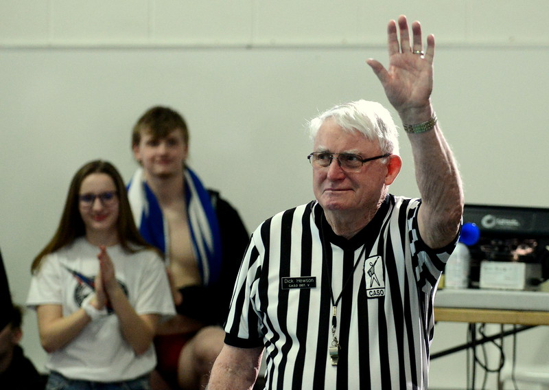 Dick Hewson, the father of swimming in Loveland, acknowledges the crowd as he was honored at the start of the Mountain View Invitational swim meet at the Mountain View Aquatic Center on Saturday. Hewson, who started the Loveland Swim Club and the swim programs at Loveland and Thompson Valley high schools, is retiring from officiating at the end of the  year. (Mike Brohard/Loveland Reporter-Herald)