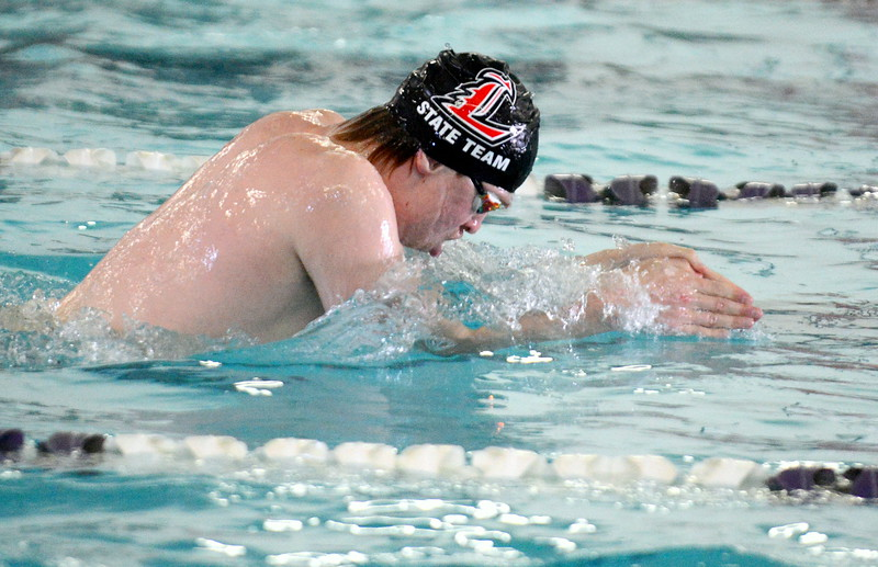 Loveland's Danny Turner cuts his way to a second-place finish in the 100-yard breaststroke at Saturday's Mountain View Invitational at the Mountain View Aquatic Center. (Mike Brohard/Loveland Reporter-Herald)