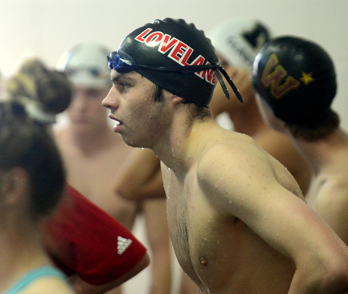 Loveland's Ashton Lyon tries to catch his breath behind the blocks after competing in the 200-yard medley relay at Saturday's Mountain View Invitational at the Mountain View Aquatic Center. (Mike Brohard/Loveland Reporter-Herald)