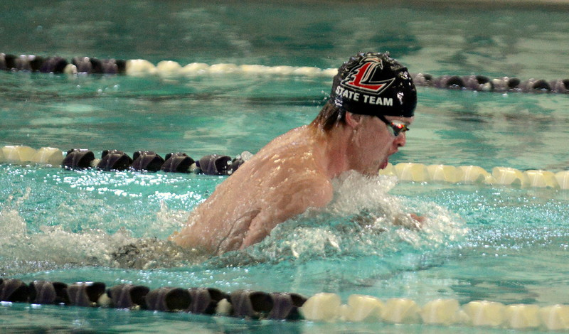 Loveland's Danny Turner swims the breaststroke leg of the 200-yard medley relay at Saturday's Mountain View Invitational at the Mountain View Aquatic Center. (Mike Brohard/Loveland Reporter-Herald)