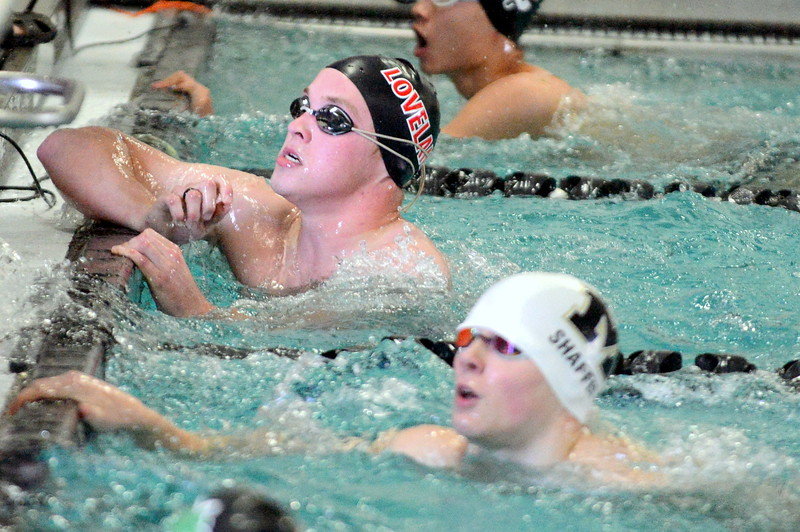Loveland's Mason Alexander looks up at the board for his 11th-place time in the 50-yard freestyle at Saturday's Mountain View Invitational at the Mountain View Aquatic Center. (Mike Brohard/Loveland Reporter-Herald)