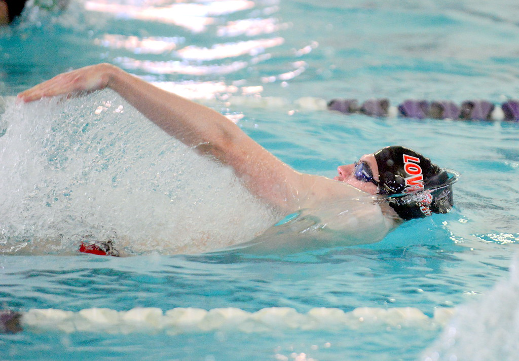 . Loveland\'s Ashton Lyon swims the backstroke leg in winning the consolation final of the 200-yard individual medley at Saturday\'s Mountain View Invitational at the Mountain View Aquatic Center. (Mike Brohard/Loveland Reporter-Herald)