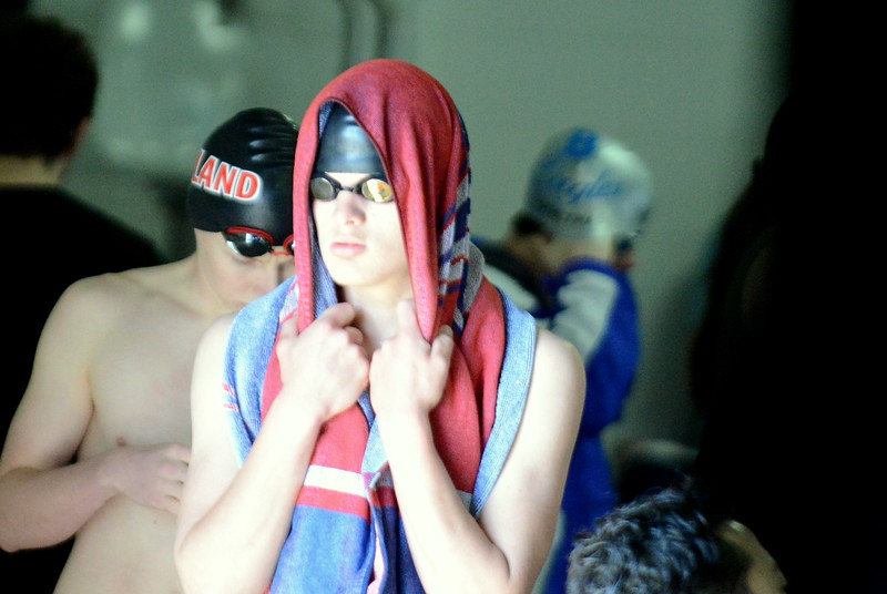 Loveland's Gavin Quinlan composes himself prior to the start of the 100-yard backstroke finals at Saturday's Mountain View Invitational at the Mountain View Aquatic Center. (Mike Brohard/Loveland Reporter-Herald)