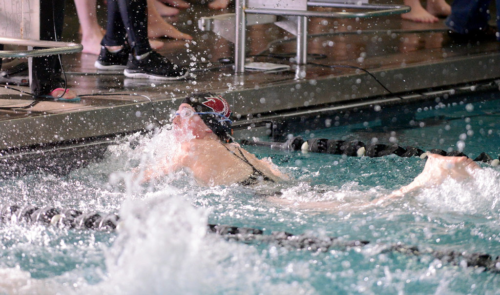 . Berthoud\'s Kysa Keck takes an immedaite look at the board at the end of the 100-yard freestyle at Saturday\'s Mountain View Invitational at the Mountain View Aquatic Center. (Mike Brohard/Loveland Reporter-Herald)