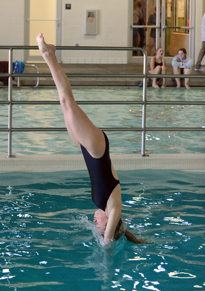 Thompson Valley diver Daphne Juergensen enters the water at Saturday's Mountain View Invitational at the Mountain View Aquatic Center. (Mike Brohard/Loveland Reporter-Herald)