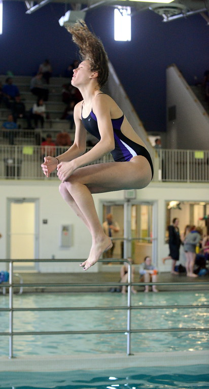 . Mountain View\'s Laurene Powell spins through a dive at Saturday\'s Mountain View Invitational at the Mountain View Aquatic Center. (Mike Brohard/Loveland Reporter-Herald)