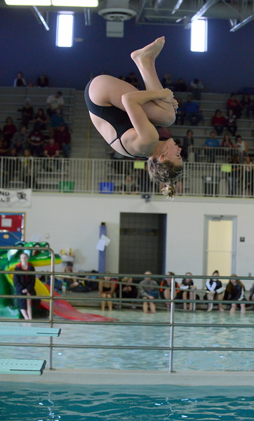 Thompson Valley diver Ryley Williams gets ready to come out of her tuck at Saturday's Mountain View Invitational at the Mountain View Aquatic Center. (Mike Brohard/Loveland Reporter-Herald)