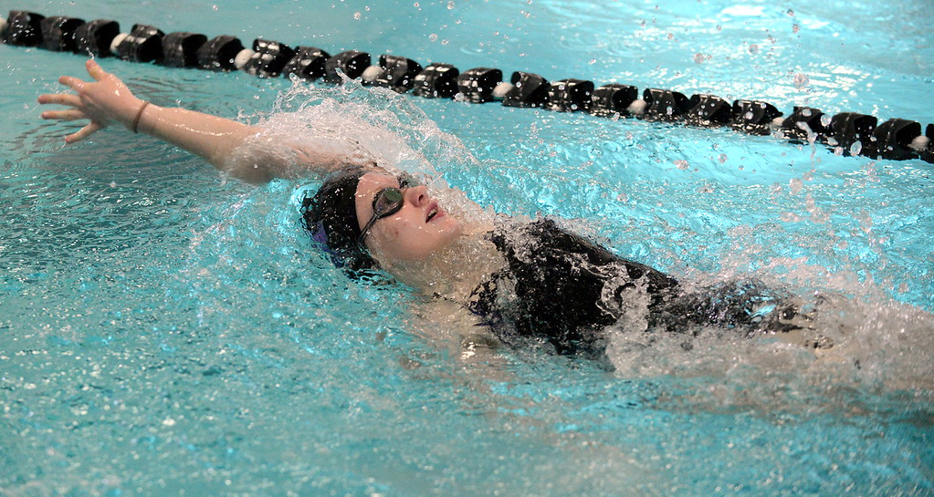 . Mountain View\'s Tasha Reichhardt competes in the 100-yard backstroke at Saturday\'s Mountain View Invitational at the Mountain View Aquatic Center. (Mike Brohard/Loveland Reporter-Herald)