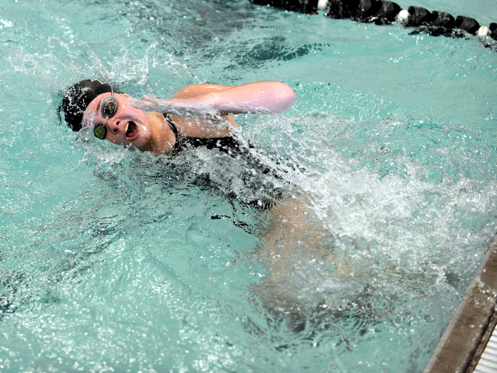 . Berthoud\'s Abby Dodd pushes off the wall during the 100-yard butterfly at Saturday\'s Mountain View Invitational at the Mountain View Aquatic Center. (Mike Brohard/Loveland Reporter-Herald)