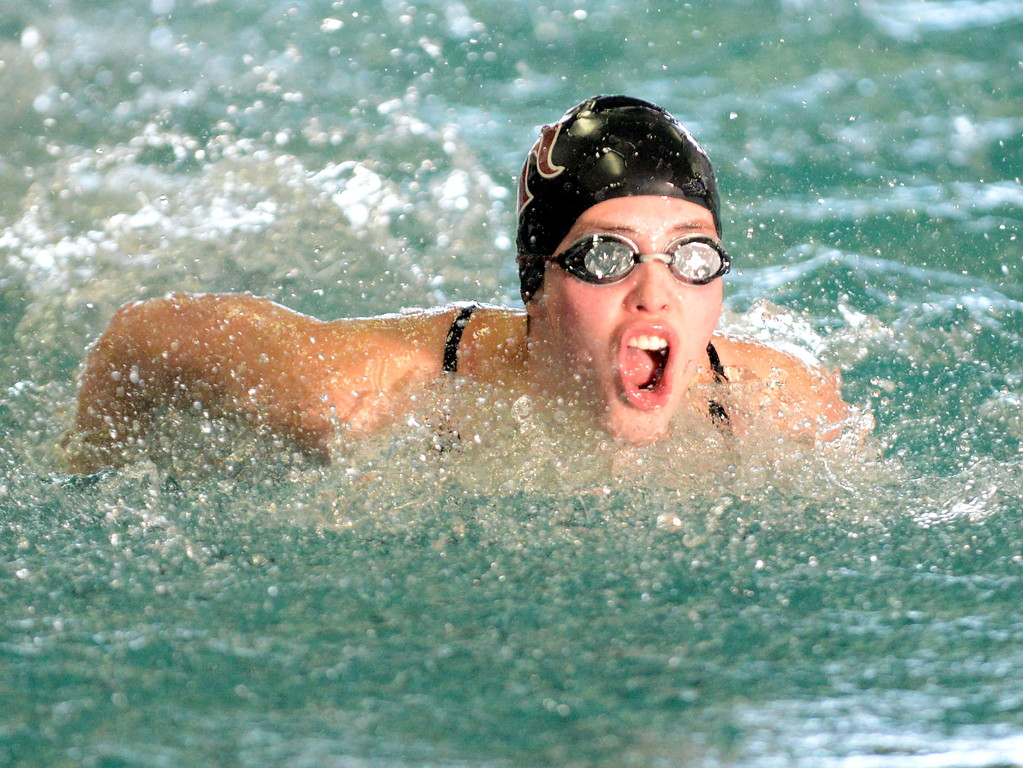 . Sarah McCormicks swims the butterfly leg of Berthoud\'s 200-yard medley relay at Saturday\'s Mountain View Invitational at the Mountain View Aquatic Center. (Mike Brohard/Loveland Reporter-Herald)