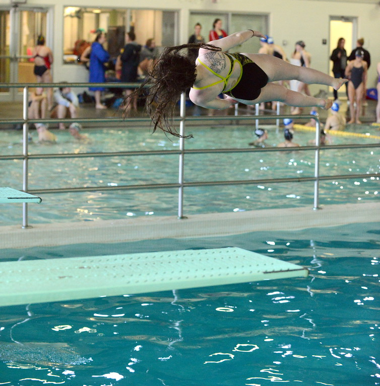 . Thompson Valley diver Bella Hubbard follows through on a twist at Saturday\'s Mountain View Invitational at the Mountain View Aquatic Center. (Mike Brohard/Loveland Reporter-Herald)