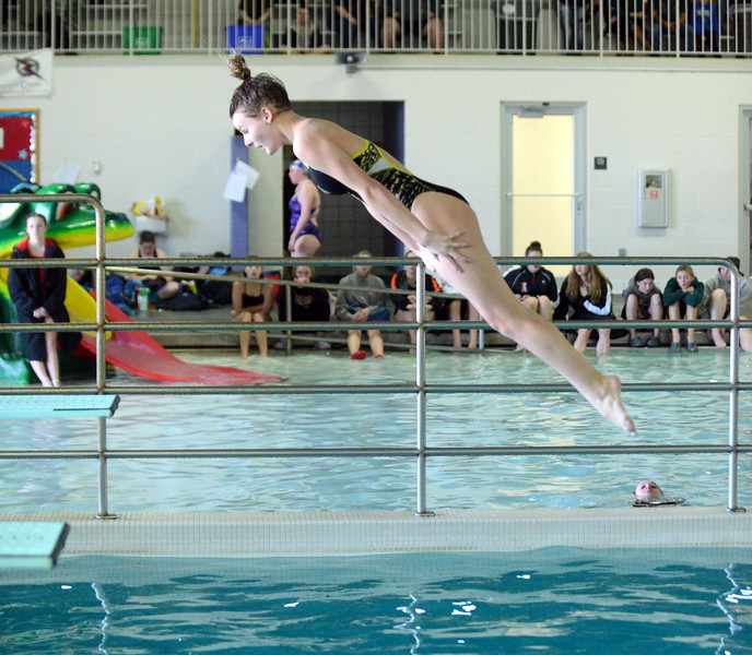 Thompson Valley diver Clara Stewart looks for the water at Saturday's Mountain View Invitational at the Mountain View Aquatic Center. (Mike Brohard/Loveland Reporter-Herald)