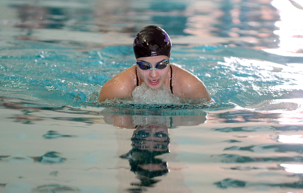 . Sophie Busse\'s reflection leads her on the way to a fifth-place showing in the 100-yard breaststroke at Saturday\'s Mountain View Invitational at the Mountain View Aquatic Center. (Mike Brohard/Loveland Reporter-Herald)