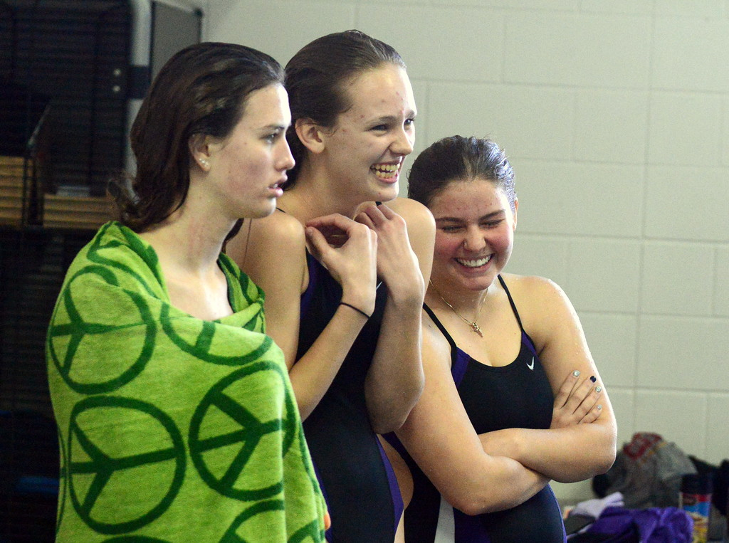 . Mountain View divers Laurene Powell (center) and Taylor Lenhart joke around as they watch the competition with Berthoud\'s Sarah McCormick at Saturday\'s Mountain View Invitational at the Mountain View Aquatic Center. (Mike Brohard/Loveland Reporter-Herald)