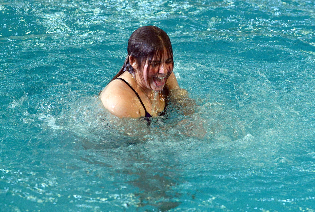 . Taylor Lenhart of Mountain View emerges from the well happy with her dive at Saturday\'s Mountain View Invitational at the Mountain View Aquatic Center. (Mike Brohard/Loveland Reporter-Herald)